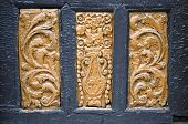 stock photo of carving  - ancient wood carving on door background and texture - JPG