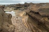 stock photo of naturist  - Gran Canaria El Confital beach at the edge of Las Palmas eroded sandstone patterns - JPG
