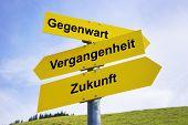 picture of past future  - Three yellow arrow signs with German caption Gegenwart Vergangenheit Zukunft  - JPG