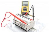 stock photo of  multimeter  - Electric switch on the control panel with multimeter - JPG