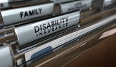 pic of disability  - File with focus on the text Disability Insurance and blur effect - JPG