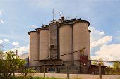 pic of silos  - Old industrial silos under blue sky - JPG