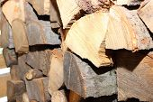 pic of firewood  - Stacks of chopped firewood prepared for winter - JPG