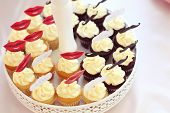 stock photo of eat me  - Capture of Delicious muffins with Eat Me text - JPG