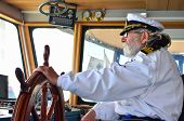 picture of working-dogs  - Ship navigation experienced captain old sea dog with grey hair and beard on his working place ship navigation cabine - JPG