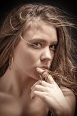 picture of thinker  - pretty girl thinker with fluffy hair portrait - JPG
