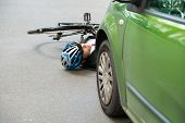 picture of accident victim  - Unconscious Male Cyclist Lying On Street After Road Accident - JPG