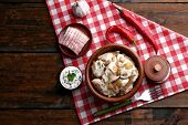 picture of liver fry  - Tasty dumplings with fried onion in brown bowl - JPG