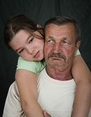 image of grandfather  - Grandfather and his granddaughter hugging - JPG