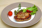 image of roasted pork  - Roasted pork with pepper and salad leaves - JPG