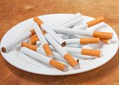 picture of quit  - A pile of cigarettes on a plate closeup - JPG