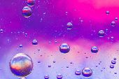 foto of psychedelic  - Psychedelic oil and water abstract background in blue - JPG