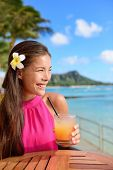 foto of waikiki  - Cocktail woman drinking alcohol drinks at beach bar resort in Waikiki - JPG