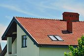 pic of attic  - Tile roof of the house with attic - JPG