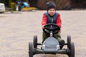 stock photo of car ride  - Boy riding a toy car  - JPG