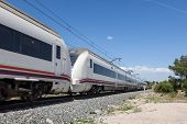 stock photo of passenger train  - Fast moving passenger train with motion blur - JPG