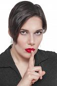 stock photo of taboo  - Beautiful plus size woman with finger on lips isolated on white background - JPG