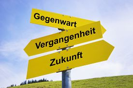 stock photo of past future  - Three yellow arrow signs with German caption Gegenwart Vergangenheit Zukunft  - JPG