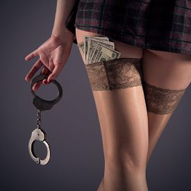 stock photo of stocking-foot  - Female prostitution violation of the law nude female hip fan of banknotes payment for services selling body for money square image feet in nylon stockings steel handcuffs - JPG