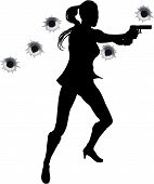 stock photo of gunfights  - Female action hero standing and shooting in film style shoot out action sequence - JPG