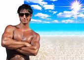Handsome man  with ideal beach landscape  - Clipping path on the man easy to cut him out - perfect f