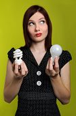 image of fluorescent light  - Woman holding fluorescent and incandescent light bulbs - JPG
