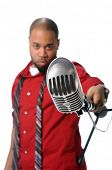 African American man with vintage microphone - Depth of Field limited to microphone poster