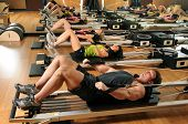 pic of pilates  - Pilates class with men and women at a gym - JPG