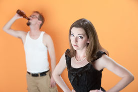 picture of wife-beater  - Unhappy Caucasian wife with alcoholic husband on orange background - JPG