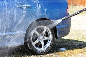 stock photo of car wash  - Blue car washing on open air - JPG