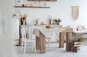 White Textured Kitchen In The Style Of Shabby. A Large Table In An Ecological Style And Loft Style.  poster