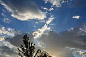 Clouds With Sunbeams, Bright Sunshine Behind Storm Clouds, Dramatic poster