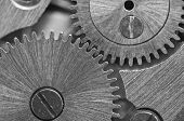 Macro. Black And White Background With Metal Cogwheels Close-up Clockwork. Conceptual Photo For Your poster