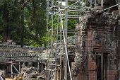 Ancient Stone Ruin Of Banteay Kdei Temple, Angkor Wat, Cambodia. Ancient Temple Restoration With Sca poster