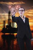 stock photo of oil rig  - virtual bureau in the  extraction sector and world oil market - JPG