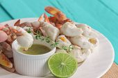 Hand Hold Steamed Crab Meat To Eat With Thai Style Spicy Dipping Sauce. Steamed Crab Meat On White P poster