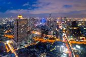 Aerial View Of Bangkok Modern Office Buildings, Condominium In Bangkok City Downtown With Sunset Sky poster