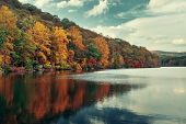 Autumn colorful foliage with lake reflection. poster