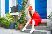 Woman Stylish Outfit Sit On Stairs Near Entrance House Picturesque Street In Paris. Paris Known As C poster