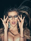 Funky Style Beauty. Sensual Woman Wear Fashion Glasses And Bra. Woman With Magnified Eyes. Beauty Mo poster