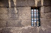 The Nostalgic Window Of An Old Masonry With Escape-proof Iron Bars As Window Bars. poster