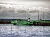 stock photo of hydrofoil  - phoro of quayside with green hydrofoil near it - JPG
