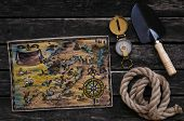 Treasure Map, Compass, Shovel And Rope On Old Wooden Table Background. Treasure Hunter Concept. poster