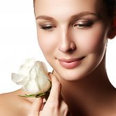 Pretty Face Of Beautiful Young Woman With Rose On Hands - White Background. Beauty Face Of Young Wom poster