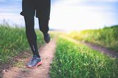 Close-up Jogging And Running Outdoors In Nature. Run People Outdoor. Athlete Wearing In Trainers And poster