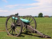 Civil War Cannon With House And Man On A Horse In The Background poster