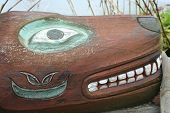 picture of tlingit  - Figure on Tlingit Alaska Native totem pole on historic Shakes Island at Wrangell - JPG