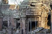Ancient Stone Ruin In Angkor Wat Temple. Aged Stone Building With Scaffolding. Khmer Heritage Temple poster