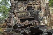 Ancient Stone Ruin In Angkor Wat Temple. Demolished Temple With Carved Bas-relief. Khmer Heritage Ru poster