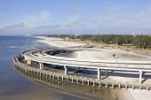 foto of katrina  - The ramp to the interstate highay 110 in Biloxi Missippi blocks the beach so a walkway was construted after Hurricane Katrina - JPG